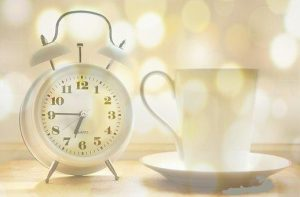 cup of coffee with clock at 6:45 as per routine