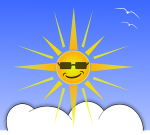 bright sun with sunglasses rising above the clouds