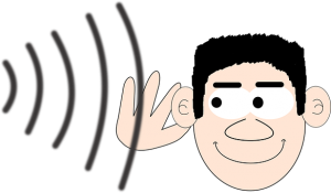 man listening with hand on ear
